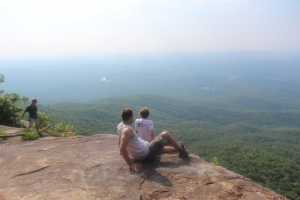 Grant and Ashten perched atop Pinnacle as Alan (left) takes in the views